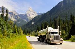 A Gibsons truck hauls propane along the Trans Canada Highway in Glacier National Stock Photos
