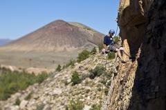 A man rappelling after rock climbing in St. George, Utah Kuvituskuvat