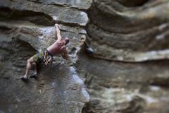 A strong male climber sport climbing RoShampo 12a, Red River Gorge, Kentucky Kuvituskuvat