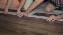 Worker puts the board flooring Stock Footage