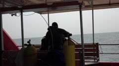 Scuba diver takes off at stern of research vessel Stock Footage