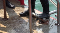 Scuba divers are helping to undress after dive Stock Footage
