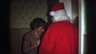 1974: the santa claus celebrating christmas joy with kids LYNBROOK, NEW YORK Stock Footage