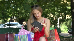 Worried girl have no money in purse after shopping  Stock Footage