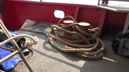 Bollard on board with tangled cables main deck ship on sea Stock Footage