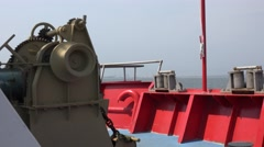 Anchor windlass hoist motor on main deck ship on sea Stock Footage