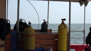 Oxygen cylinders for diving on scientific ship on background of cargo ship Stock Footage