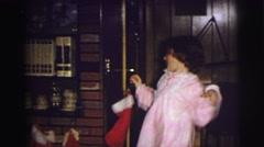 1974: kids in pajamas dancing around and hanging christmas stockings LYNBROOK, Stock Footage