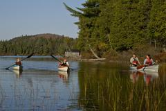 Family canoeing on Source Lake, Algonquin Park, Ontario, Canada. Stock Photos