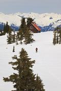 A skier ascends the trail to Mt. Steele cabin in Tetrahedron Provincial Park on Stock Photos