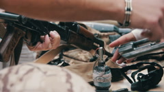 Weapons, Automatic Machines, Grenades, Ammunition, Bullets are on the Table, and Stock Footage