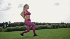 Slim athletic woman doing frontal lunge and squats Stock Footage