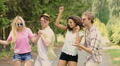 Multiethnic group of friends dancing and jumping at music open-air festival HD Footage