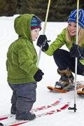 A young mother and baby son snowshoeing in Poccaterra, Peter Lougheed Park, Stock Photos