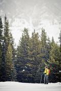 A young man snowshoeing at Peter Lougheed Provincial Park, Kananaskis, AB Stock Photos