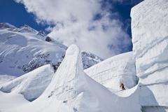 A backcountry skier touring up a heavily crevassed glacier at Icefall Lodge, Stock Photos