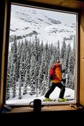 A male backcountry skier heading out for an early morning ski tour. Icefall Stock Photos