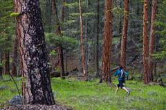 A young asian woman trail running in the 3 Blind Mice trail system. Penticton, Stock Photos