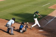 A hitter makes contact with the baseball during a men's tournament in Kamloops, Stock Photos