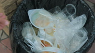 Dirt Plastic tableware in the bin Stock Footage
