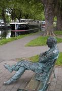 Sculpture of Irish poet Patrick Kavanagh (1904-1967), located on the bank of the Stock Photos