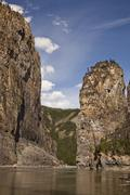 Canoe and raft pass The 'Pulpit' rock formation on the Nahanni River, Nahanni Stock Photos