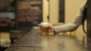 Man catches a full beer mug on the table Stock Footage