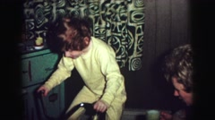 1974: kid receives bicycle sits on it with a gigantic smile ready to go Stock Footage