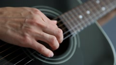 Unrecognizable woman playing guitar, closeup shot Stock Footage