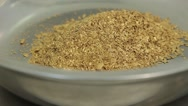 Golden sand in a bowl Stock Footage