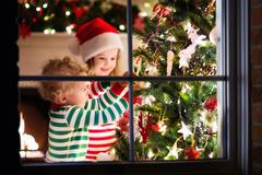 Kids decorating Christmas tree Stock Photos