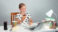 Girl 7-8 years eating bread with jam butter sitting at the table isolated Stock Footage