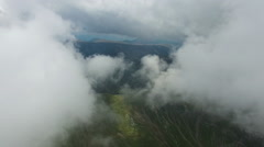 Aerial view of Bucegi mountains, Romania, flight from the first layer of clou Stock Footage