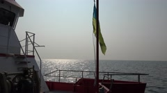 Ukrainian flag on quarterdeck develops research vessel in morning at dawn Stock Footage
