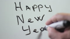 """Hand writing title """"Happy new year"""" using a black marker on a white board Stock Footage"""