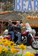 Motorcycle touring couple stops at a fruit stand in Keremeos in the Similkameen Stock Photos