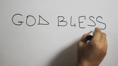 "Hand writing a ""god bless america"" message on a white board using a black marker Stock Footage"