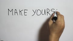 "Hand writing a ""make yourself proud"" message on a white board Stock Footage"