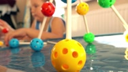 Little boy playing with colorful plastic construction set. Molecule models. 4K Stock Footage
