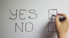 "Hand writing title ""YES NO"" using a black marker on a white board Stock Footage"
