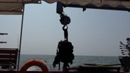 Lifebuoy and scuba diving equipment in background horizon in sea Stock Footage