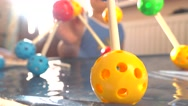 Boy playing with colorful plastic construction set. Balls and pins. 4K close up Stock Footage