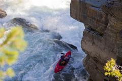 A male kayaker runs the challenging section of the Upper Elk River, Fernie, BC Stock Photos