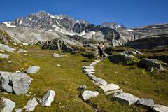 A young man alpine climbing the west ridge of Mt Tupper, Roger's Pass, Glacier Stock Photos