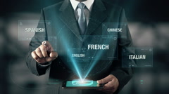 Portuguese Language Choose Businessman using digital tablet technology Stock Footage