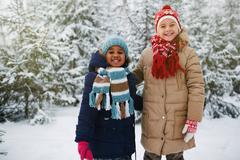Affectionate little girls in winter park Stock Photos