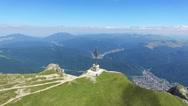 Aerial view of the Heroes Cross on Caraiman Peak, Romania, tilt Stock Footage