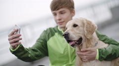 Boy Taking Selfie with Dog Stock Footage
