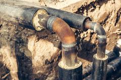 Maintenance of industrial pipes for heating water transport Stock Photos