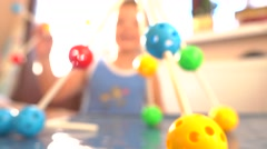 Boy playing with colored plastic construction set. Molecule models. 4K close up Stock Footage